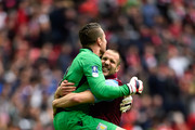 Shay Given and Ron Vlaar of Aston Villa celebrate victory after the FA Cup Semi Final between Aston Villa and Liverpool at Wembley Stadium on April 19, 2015 in London, England.