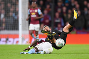 Sergio Aguero of Manchester City is tackled by Marvelous Nakamba of Aston Villa which later led to a yellow card during the Carabao Cup Final between Aston Villa and Manchester City at Wembley Stadium on March 01, 2020 in London, England.