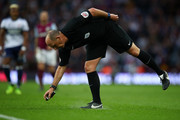 Referee Mike Dean sprays a line of paint during the Sky Bet Championship Play Off Semi Final second leg match between Aston Villa and Middlesbrough at Villa Park on May 15, 2018 in Birmingham, England.