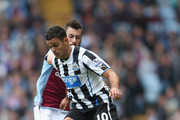 Antonio Luna of Aston Villa tangles with Hatem Ben Arfa of Newcastle United during the Barclays Premier League match between Aston Villa and Newcastle United at Villa Park on September 14, 2013 in Birmingham, England.
