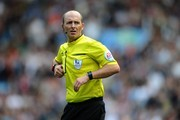 Referee Mike Dean looks on during the Barclays Premier League match between Aston Villa and Newcastle United at Villa Park on August 23, 2014 in Birmingham, England.