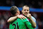 Shay Given of Aston Villa celebrates victory with Ron Vlaar of Aston Villa after the Barclays Premier League match between Aston Villa and West Ham United at Villa Park on May 9, 2015 in Birmingham, England.