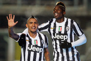 Arturo Vidal (L) of Juventus celebrates with teamt-mate Paul Pogba after scoring their fourth goal during the Serie A match between Atalanta BC and Juventus at Stadio Atleti Azzurri d'Italia on December 22, 2013 in Bergamo, Italy.