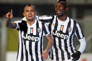 Arturo Vidal (L) and Paul Pogba of Juventus celebrate the 4th goal during the Serie A match between Atalanta BC and Juventus at Stadio Atleti Azzurri d'Italia on December 22, 2013 in Bergamo, Italy.