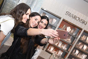 Louise Roe takes photos with fans at Atelier Swarovski and Louise Roe Celebrate Awards Season At the Grove on February 22, 2017 in Los Angeles, California.