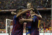 Lionel Messi (R) of Barcelona celebrates with team mates Andres Iniesta (C) and Alexis Sanchez after scoring Barcelona's second goal during the Copa del Rey Final match between Athletic Bilbao and Barcelona at Vicente Calderon Stadium on May 25, 2012 in Madrid, Spain.