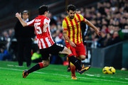 Cesc Fabregas of FC Barcelona duels for the ball with Andoni Iraola of Athletic Club during the La Liga match between Athletic Club and FC Barcelona at San Mames Stadium on December 1, 2013 in Bilbao, Spain.