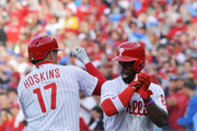 Rhys Hoskins #17 and Andrew McCutchen #22 of the Philadelphia Phillies celebrate Hoskins grand slam in the seventh inning against the Atlanta Braves on Opening Day at Citizens Bank Park on March 28, 2019 in Philadelphia, Pennsylvania.