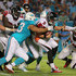 Ndamukong Suh Photos - Matt Ryan #2 of the Atlanta Falcons is sacked by Cameron Wake #91 and Ndamukong Suh #93 of the Miami Dolphins during a preseason game  at Sun Life Stadium on August 29, 2015 in Miami Gardens, Florida. - Atlanta Falcons v Miami Dolphins