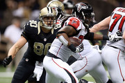 Kemal Ishmael #36 of the Atlanta Falcons is pursued by Jimmy Graham #80 of the New Orleans Saints during the fourth quarter of a game at the Mercedes-Benz Superdome on December 21, 2014 in New Orleans, Louisiana.