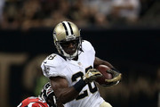 C.J. Spiller #28 of the New Orleans Saints is pushed out of bounds by Nate Stupar #54 of the Atlanta Falcons during a game at the Mercedes-Benz Superdome on October 15, 2015 in New Orleans, Louisiana.