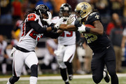 Chris Ivory #29 of the New Orleans Saints runs past  Dunta Robinson #23 of the Atlanta Falcons to score a touchdown at The Mercedes-Benz Superdome on November 11, 2012 in New Orleans, Louisiana.