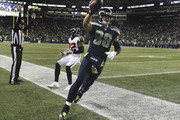 Tight end Jimmy Graham #88 of the Seattle Seahawks scores a two-point conversion in front of strong safety Keanu Neal #22 of the Atlanta Falcons during the fourth quarter of the game at CenturyLink Field on November 20, 2017 in Seattle, Washington. The Falcons won the game 34-31.