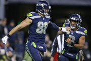 Tight end Jimmy Graham #88 of the Seattle Seahawks celebrates bringing in a two point conversion with Russell Wilson #3 during the fourth quarter of the game against the Atlanta Falcons at CenturyLink Field on November 20, 2017 in Seattle, Washington.  The Atlanta Falcons beat the Seattle Seahawks, 34-31.