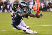 Mike Wallace #14 of the Philadelphia Eagles attempts to catch the ball as he is defended by Robert Alford #23 of the Atlanta Falcons during the second half at Lincoln Financial Field on September 6, 2018 in Philadelphia, Pennsylvania.