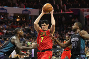 Ersan Ilyasova #7 of the Atlanta Hawks drives to the basket against teammates Marvin Williams #2 and Michael Kidd-Gilchrist #14 of the Charlotte Hornets during their game at Spectrum Center on January 26, 2018 in Charlotte, North Carolina.  NOTE TO USER: User expressly acknowledges and agrees that, by downloading and or using this photograph, User is consenting to the terms and conditions of the Getty Images License Agreement.