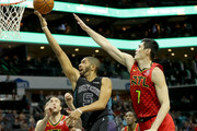 Nicolas Batum #5 of the Charlotte Hornets drives to the basket against teammates Miles Plumlee #18 and Ersan Ilyasova #7 of the Atlanta Hawks during their game at Spectrum Center on January 26, 2018 in Charlotte, North Carolina.  NOTE TO USER: User expressly acknowledges and agrees that, by downloading and or using this photograph, User is consenting to the terms and conditions of the Getty Images License Agreement.