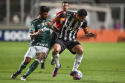 Fred #99 of Atletico MG and Santos #21 of Palmeiras battle for the ball during a match between Atletico MG and Palmeiras as part of Brasileirao Series A 2016 at Independencia stadium on November 17, 2016 in Belo Horizonte, Brazil.