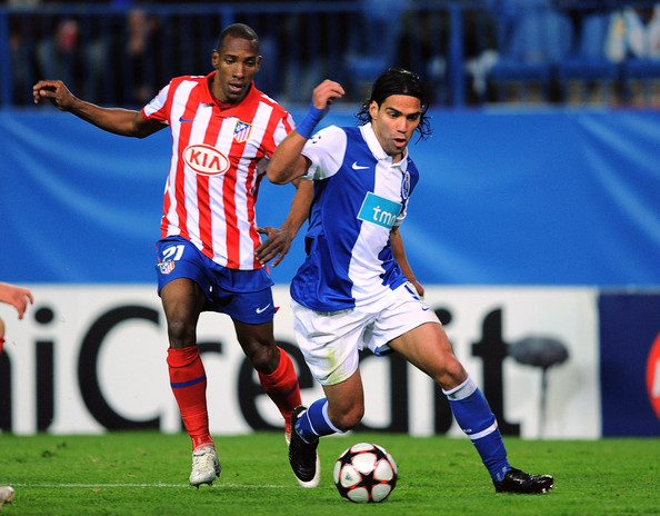 Falcao Falcao (R) of FC Porto beats Luis Parea of Atletico Madrid during the UEFA Champions League Group D match between Atletico Madrid and FC Porto at the Vicente Calderon stadium on December 8, 2009 in Madrid, Spain.