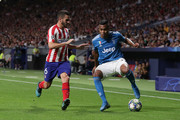 Alex Sandro (R) of Juventus competes for the ball with Koke (L) of Atletico de Madrid during the UEFA Champions League group D match between Atletico Madrid and Juventus at Wanda Metropolitano on September 18, 2019 in Madrid, Spain.