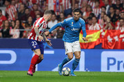 Cristiano Ronaldo of Juventus runs at Kieran Trippier of Atletico Madrid  during the UEFA Champions League group D match between Atletico Madrid and Juventus at Wanda Metropolitano on September 18, 2019 in Madrid, Spain.