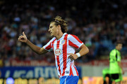 Diego Forlan of Atletico Madrid signals to a teammate during the La Liga match between Atletico Madrid and Real Zaragoza at the Vicente Calderon stadium on September 26, 2010 in Madrid, Spain.