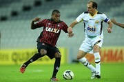 Marcelo of Atletico-PR competes for the ball with Paulo Baier of Criciuma during the match between Atletico-PR and Criciuma for the Brazilian Series A 2014 at Arena da Baixada stadium on July 20, 2014 in Curitiba, Brazil.