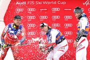 Vincent Kriechmayr #3 of Austria watches as Kjetil Jansrud #15 of Norway helps Hannes Reichelt #7 of Austria open his celebratory bottle of champagne on the medals podium after the Men's Super-G during the Audi Birds of Prey World Cup on December 1, 2017 in Beaver Creek, Colorado.