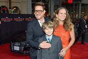 (L-R) Actor Robert Downey Jr., actor Ty Simpkins, and Susan Downey attend the U.S. Premiere of Marvel's Iron Man 3 hosted by Audi at the El Capitan Theatre on April 24, 2013 in Hollywood, California.