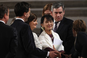 British Prime Minister David Cameron (L), opposition Labour Party leader Ed Miliband (2nd L), Cherie Blair QC (3rd L), and former British Prime Minister Gordon Brown (2nd R) meet with Myanmar opposition leader Aung San Suu Kyi after addressing both Houses of Parliament on June 21, 2012 in London, England. both Houses of Parliament at Westminster Hall. The Burmese opposition leader is on a four-day visit to the UK.