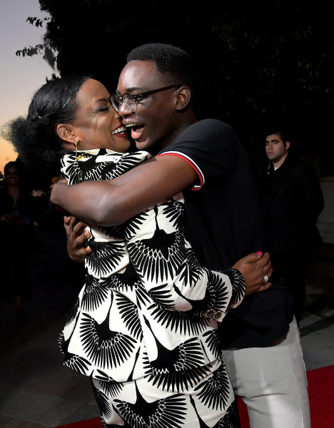 Netflix's 'When They See Us' Screening And Reception [when they see us screening reception,interaction,fashion,hug,dance,event,photography,muscle,performing arts,fashion design,ethan herisse,aunjanue ellis,lot,california,hollywood,paramount theater,netflix,paramount studios]
