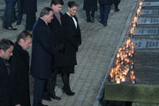Swedish Crown Princess Victoria, Swedish Prime Minister Stefan Löfven and her husband Prince Daniel look at candles at the Auschwitz Memorial during the official ceremony to mark the 75th anniversary of the liberation of the Auschwitz concentration camp at the Auschwitz-Birkenau site on January 27, 2020 near Oswiecim, Poland. International leaders as well as approximately 200 survivors and their families are gathering today at Auschwitz today to attend the commemoration. The Nazis killed an estimated one million people at the camp during the World War II occupation of Poland by Nazi Germany. The Soviet Army liberated the camp on January 27, 1945.