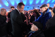 Andrew Cuomo (L), Governor of the state of New York, chats with Rabbi Meyer Kizelnik (seated), a childhood survivor of the Auschwitz concentration camp, prior to the official ceremony to mark the 75th anniversary of the liberation of the camp at the Auschwitz-Birkenau site on January 27, 2020 near Oswiecim, Poland. International leaders as well as approximately 200 survivors and their families are gathering at Auschwitz today to attend the commemoration. The Nazis killed an estimated one million people at the camp during the World War II occupation of Poland by Nazi Germany. The Soviet Army liberated the camp on January 27, 1945.