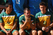Tim Cahill, Lucas Neill and Harry Kewell of the Australian Socceroos relax prior to an official 2010 FIFA World Cup team photo at Kloofzicht Lodge on June 21, 2010 in Muldersdrift, South Africa.