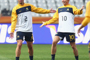 Lucas Neill and Harry Kewell of Australia gesture during an Australian Socceroos training session at the Mbombela Stadium on June 22, 2010 in Nelspruit, South Africa.