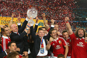 Injured Lions players Paul O'Connell and Brian O'Driscoll hold the Tom Richards Cup aloft after winning the International Test match between the Australian Wallabies and British & Irish Lions at ANZ Stadium on July 6, 2013 in Sydney, Australia.