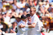 Stuart Broad of England is congratulated by Ian Bell and Jonny Bairstow after taking the wicket of Steve Smith of Australia during day two of the Fourth Ashes Test Match between Australia and England at Melbourne Cricket Ground on December 27, 2013 in Melbourne, Australia.