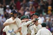 Ausralia celebrate after Pat Cummins of Australia claiimed the fianl wicket of Chris Woakes of England to claim victory during day five of the Third Test match during the 2017/18 Ashes Series between Australia and England at WACA on December 18, 2017 in Perth, Australia.