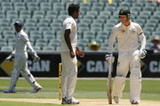 Michael Clarke speaks to Varun Aaron of India after ducking a bouncer off his first bowl faced off during day one of the First Test match between Australia and India at Adelaide Oval on December 9, 2014 in Adelaide, Australia.