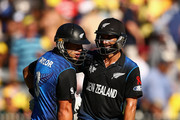 Ross Taylor of New Zealand and team mate Grant Elliott talk during the 2015 ICC Cricket World Cup final match between Australia and New Zealand at Melbourne Cricket Ground on March 29, 2015 in Melbourne, Australia.