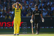 Shane Watson of Australia looks frustrated as Grant Elliott of New Zealand laughs after a near chance during the 2015 ICC Cricket World Cup final match between Australia and New Zealand at Melbourne Cricket Ground on March 29, 2015 in Melbourne, Australia.