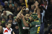 Greg Inglis of the Kangaroos celebrates with Johnathan Thurston after scoring a try during the ANZAC Test match between the Australian Kangaroos and the New Zealand Kiwis at Canberra Stadium on April 19, 2013 in Canberra, Australia.