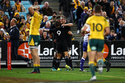 Aaron Smith of the All Blacks celebrates with his team mates Kieran Read and Liam Squire of the All Blacks after scoring a try during The Rugby Championship Bledisloe Cup match between the Australian Wallabies and the New Zealand All Blacks at ANZ Stadium on August 18, 2018 in Sydney, Australia.