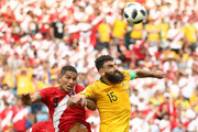 Paolo Guerrero of Peru competes for a header with Mile Jedinak of Australia during the 2018 FIFA World Cup Russia group C match between Australia and Peru at Fisht Stadium on June 26, 2018 in Sochi, Russia.