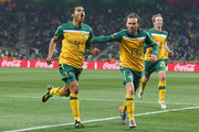 Tim Cahill of Australia (L) celebrates scoring the opening goal with team mates Brett Holman and David Carney (R) during the 2010 FIFA World Cup South Africa Group D match between Australia and Serbia at Mbombela Stadium on June 23, 2010 in Nelspruit, South Africa.