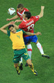 Tim Cahill of Australia jumps for the ball under pressure from Aleksandar Lukovic and Nemanja Vidic of Serbia during the 2010 FIFA World Cup South Africa Group D match between Australia and Serbia at Mbombela Stadium on June 23, 2010 in Nelspruit, South Africa.