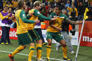 Tim Cahill of Australia celebrates scoring the opening goal with team mates David Carney and Brett Holman during the 2010 FIFA World Cup South Africa Group D match between Australia and Serbia at Mbombela Stadium on June 23, 2010 in Nelspruit, South Africa.