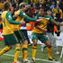 Brett Holman David Carney Photos - Tim Cahill of Australia celebrates scoring the opening goal with team mates David Carney and Brett Holman during the 2010 FIFA World Cup South Africa Group D match between Australia and Serbia at Mbombela Stadium on June 23, 2010 in Nelspruit, South Africa. - Australia v Serbia: Group D - 2010 FIFA World Cup