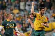 Michael Hooper and Adam Ashley-Cooper of the Wallabies celebrate victory at the final whistle as Bryan Habana of the Springboks looks on during The Rugby Championship match between the Australian Wallabies and the South African Springboks at Patersons Stadium on September 6, 2014 in Perth, Australia.