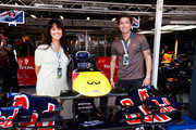 Footballer Harry Kewell and his wife, presenter Sheree Murphy are seen in the Red Bull Racing garage before the Australian Formula One Grand Prix at the Albert Park circuit on March 18, 2012 in Melbourne, Australia.